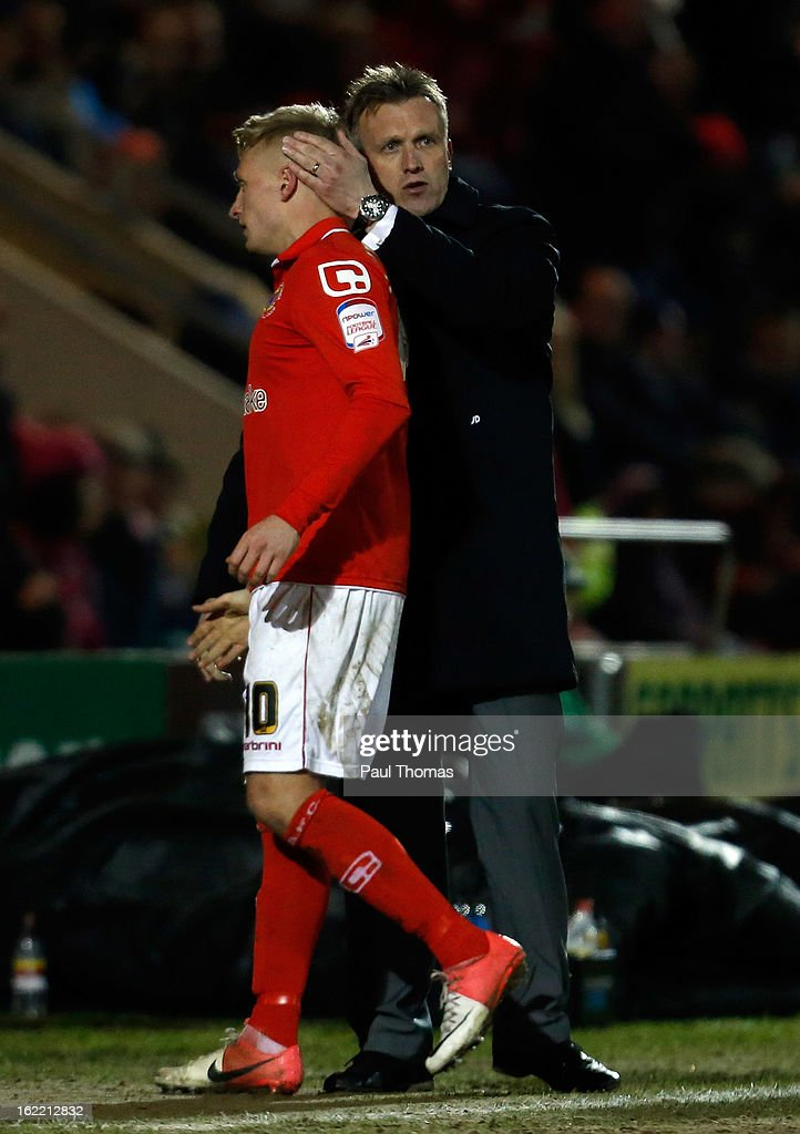 Manager Steve Davis (R) of Crewe congratulates his player AJ Leitch-Smith as he is substituted during the Johnstone's Paint Trophy Northern Section Final Second Leg match between Crewe Alexandra and Coventry City at the Alexandra Stadium on February 20, 2013 in Crewe, England.