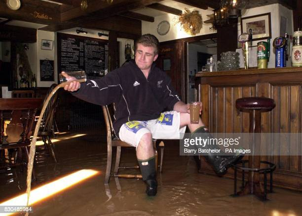 Manager Steve Roper in the flooded bar of The Cross Keys pub at Norton Fitzwarren in Somerset Parts of Britain were lashed by a massive storm...