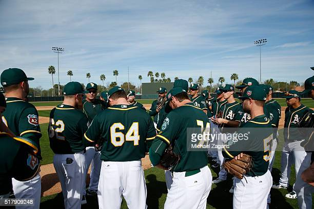 Manager Steve Scarsone of the Oakland Athletics AAA team the Nashville Sounds meets with infields are pitchers during a spring training workout at...
