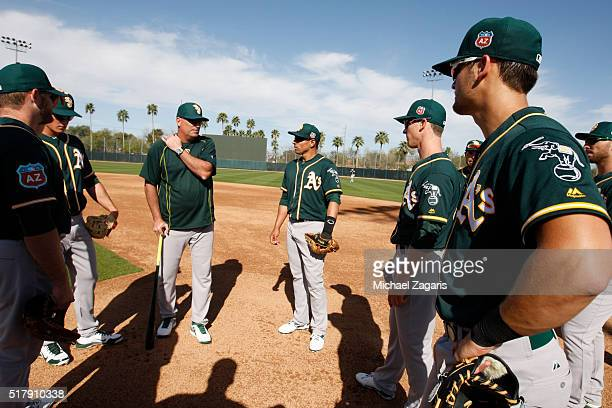 Manager Steve Scarsone of the Oakland Athletics AAA team the Nashville Sounds readies the team for infield drills during a spring training workout at...