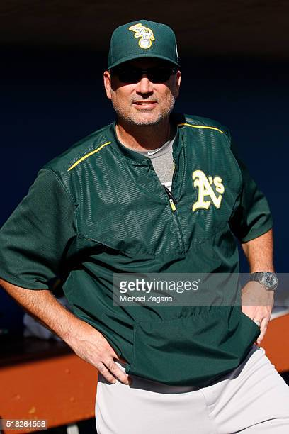Manager Steve Scarsone of the Oakland Athletics AAA team the Nashville Sounds stands in the dugout prior to a spring training game against the...