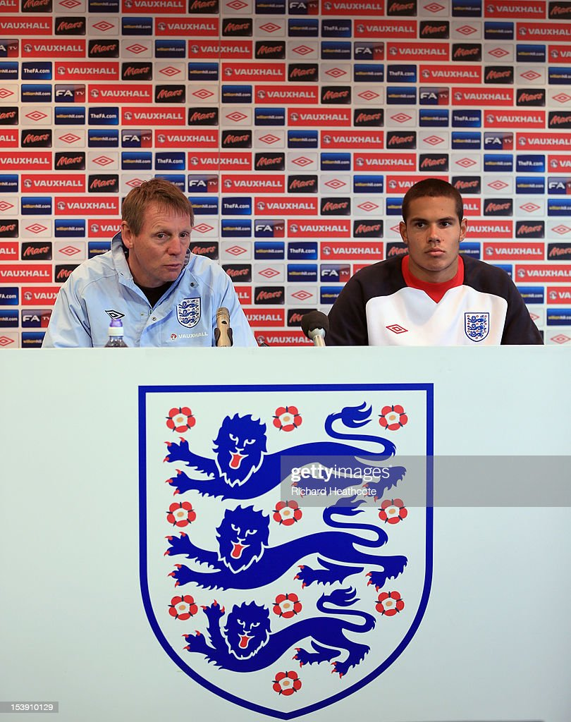 U21 manager Stuart Pearce and player Jack Rodwell (R) talk to the media in a press conference after the England U21 training session at Carrow Road on October 11, 2012 in Norwich, England. England's U21 team will play Serbia U21 in the first leg of the U21 European Championship play-off's at Carrow Road tomorrow night.