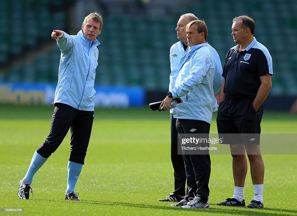 U21 manager <a gi-track='captionPersonalityLinkClicked' href=/galleries/search?phrase=Stuart+Pearce+-+Soccer+Coach&family=editorial&specificpeople=213348 ng-click='$event.stopPropagation()'>Stuart Pearce</a> talks with his asisstants during the England U21 training session at Carrow Road on October 11, 2012 in Norwich, England. England's U21 team will play Serbia U21 in the first leg of the U21 European Championship play-offs at Carrow Road tomorrow night.