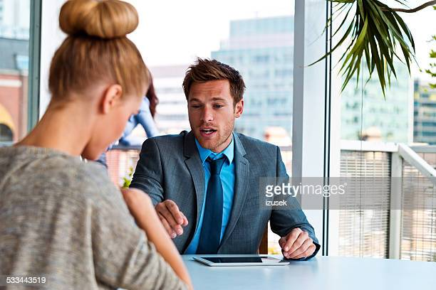 Manager talking with his business partner