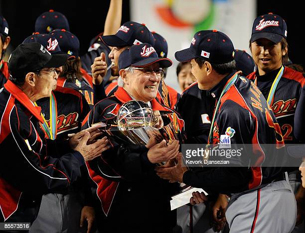 Manager Tatsunori Hara of Japan Ryozo Kato Japanese baseball commissioner and Sadaharu Oh celebrate after defeating Korea during the finals of the...