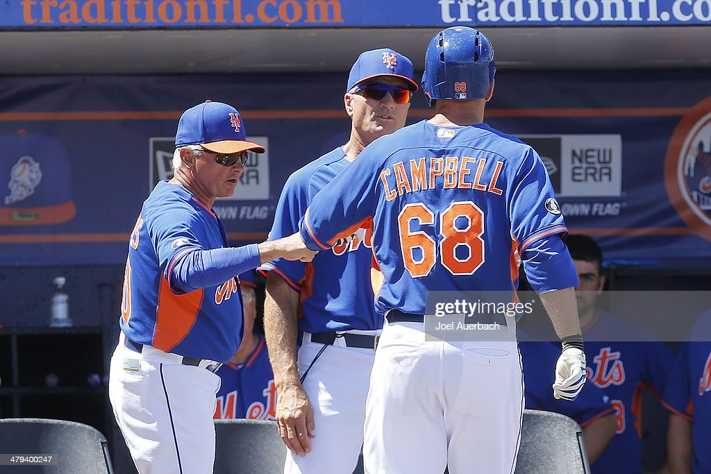 Manager <a gi-track='captionPersonalityLinkClicked' href=/galleries/search?phrase=Terry+Collins&family=editorial&specificpeople=2593404 ng-click='$event.stopPropagation()'>Terry Collins</a> #10 congratulates <a gi-track='captionPersonalityLinkClicked' href=/galleries/search?phrase=Eric+Campbell&family=editorial&specificpeople=90797 ng-click='$event.stopPropagation()'>Eric Campbell</a> #68 of the New York Mets after he hit a home run against the Detroit Tigers in the second inning during a spring training game at Tradition Field on March 18, 2014 in Port St. Lucie, Florida.