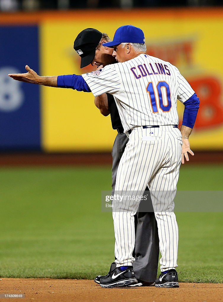 Manager Terry Collins #10 of the New York Mets argues that Eric Young Jr. was safe at second with second base umpire Jeff Kellogg in the seventh inning against the Atlanta Braves on July 23, 2013 at Citi Field in the Flushing neighborhood of the Queens borough of New York City.