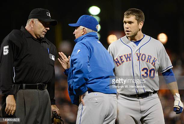 Manager Terry Collins of the New York Mets argues with home plate umpire Dale Scott for calling Josh Thole out on a doubleplay in the eighth inning...