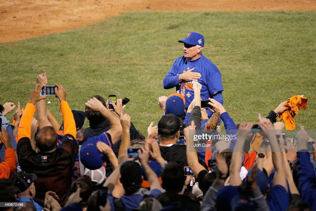 Manager Terry Collins #10 of the New York Mets celebrates on field after defeating the Chicago Cubs in game four of the 2015 MLB National League Championship Series at Wrigley Field on October 21, 2015 in Chicago, Illinois. The Mets defeated the Cubs with a score of 8 to 3 to sweep the Championship Series.