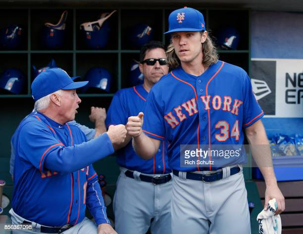 Manager Terry Collins of the New York Mets fist bumps pitcher Noah Syndergaard before the start of a game against the Philadelphia Phillies at...