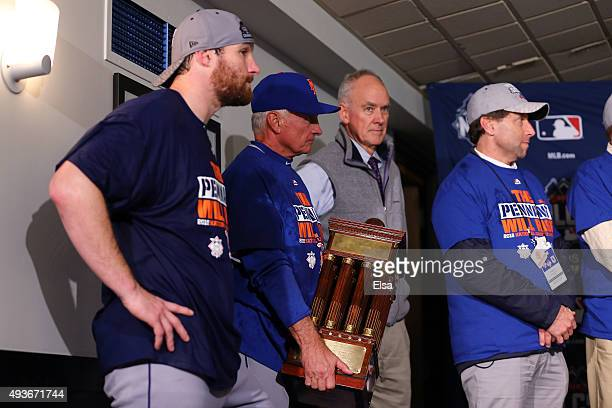 Manager Terry Collins of the New York Mets holds the NLCS trophy after defeating the Chicago Cubs in game four of the 2015 MLB National League...
