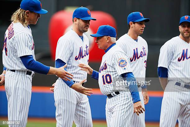 Manager Terry Collins of the New York Mets meets Matt Harvey and Noah Syndergaard before the game against the Philadelphia Phillies during the Mets...