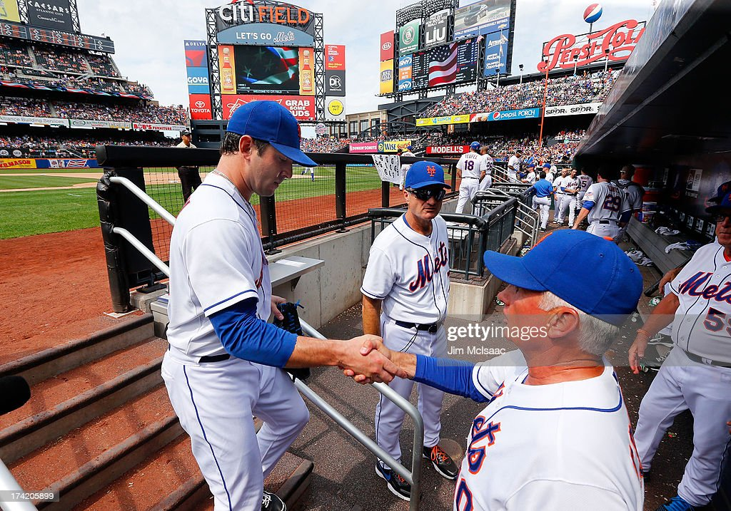 Manager Terry Collins #10 of the New York Mets shakes hands with Matt Harvey #33 after the seventh inning against the Philadelphia Phillies at Citi Field on July 21, 2013 in the Flushing neighborhood of the Queens borough of New York City.