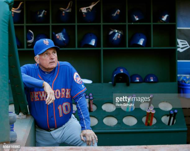 Manager Terry Collins of the New York Mets stands on the bottom step of the dugout before the start of a game against the Philadelphia Phillies at...