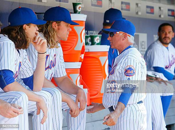 Manager Terry Collins of the New York Mets talks with Noah Syndergaard during a game against the Kansas City Royals at Citi Field on June 22 2016 in...