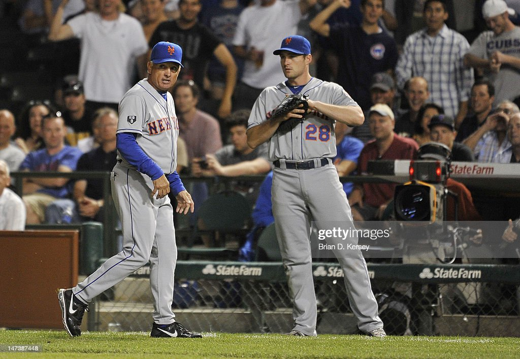 Manager Terry Collins #10 of the New York Mets (L) walks off the field after arguing a call as second baseman Daniel Murphy #28 stands on the field against the Chicago Cubs at Wrigley Field on June 26, 2012 in Chicago, Illinois. The Cubs defeated the Mets 5-3.