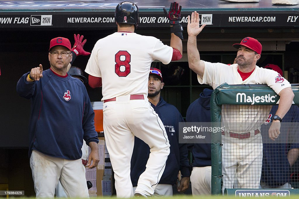 Manager <a gi-track='captionPersonalityLinkClicked' href=/galleries/search?phrase=Terry+Francona&family=editorial&specificpeople=171936 ng-click='$event.stopPropagation()'>Terry Francona</a> #17 and pitching coach <a gi-track='captionPersonalityLinkClicked' href=/galleries/search?phrase=Mickey+Callaway&family=editorial&specificpeople=3002338 ng-click='$event.stopPropagation()'>Mickey Callaway</a> #44 celebrate with <a gi-track='captionPersonalityLinkClicked' href=/galleries/search?phrase=Lonnie+Chisenhall&family=editorial&specificpeople=6796448 ng-click='$event.stopPropagation()'>Lonnie Chisenhall</a> #8 of the Cleveland Indians after Chisenhall hit a solo home run during the eighth inning against the Baltimore Orioles at Progressive Field on September 2, 2013 in Cleveland, Ohio.
