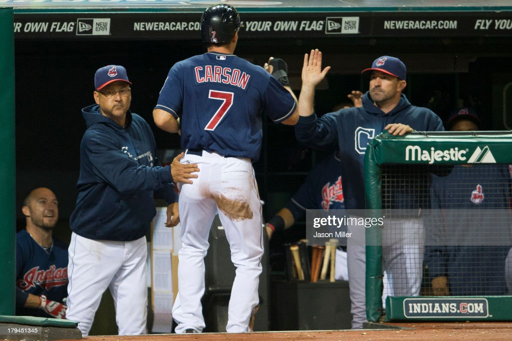 Manager <a gi-track='captionPersonalityLinkClicked' href=/galleries/search?phrase=Terry+Francona&family=editorial&specificpeople=171936 ng-click='$event.stopPropagation()'>Terry Francona</a> #17 and pitching coach <a gi-track='captionPersonalityLinkClicked' href=/galleries/search?phrase=Mickey+Callaway&family=editorial&specificpeople=3002338 ng-click='$event.stopPropagation()'>Mickey Callaway</a> #44 celebrate with Matt Carson #7 of the Cleveland Indians after Carson scored during the sixth inning against the Baltimore Orioles at Progressive Field on September 3, 2013 in Cleveland, Ohio.