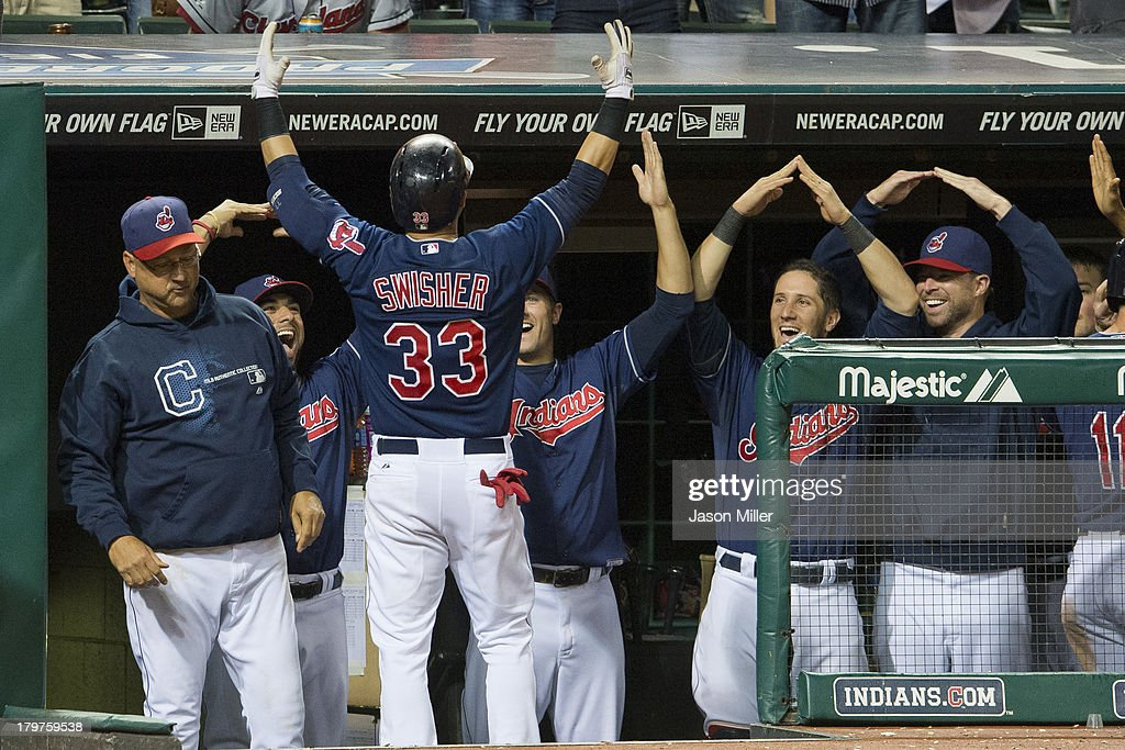 Manager <a gi-track='captionPersonalityLinkClicked' href=/galleries/search?phrase=Terry+Francona&family=editorial&specificpeople=171936 ng-click='$event.stopPropagation()'>Terry Francona</a> #17 and the rest of the dugout celebrate with <a gi-track='captionPersonalityLinkClicked' href=/galleries/search?phrase=Nick+Swisher&family=editorial&specificpeople=206417 ng-click='$event.stopPropagation()'>Nick Swisher</a> #33 of the Cleveland Indians after Swisher hit a grand slam during the eighth inning against the New York Mets at Progressive Field on September 6, 2013 in Cleveland, Ohio.