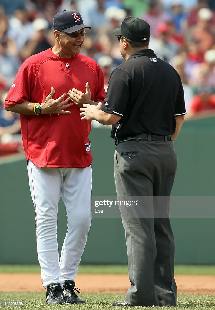 Manager <a gi-track='captionPersonalityLinkClicked' href=/galleries/search?phrase=Terry+Francona&family=editorial&specificpeople=171936 ng-click='$event.stopPropagation()'>Terry Francona</a> #47 argues a call with Marty Foster after Juan Pierre of the Chicago White Sox was called safe on June 1, 2011 at Fenway Park in Boston, Massachusetts.