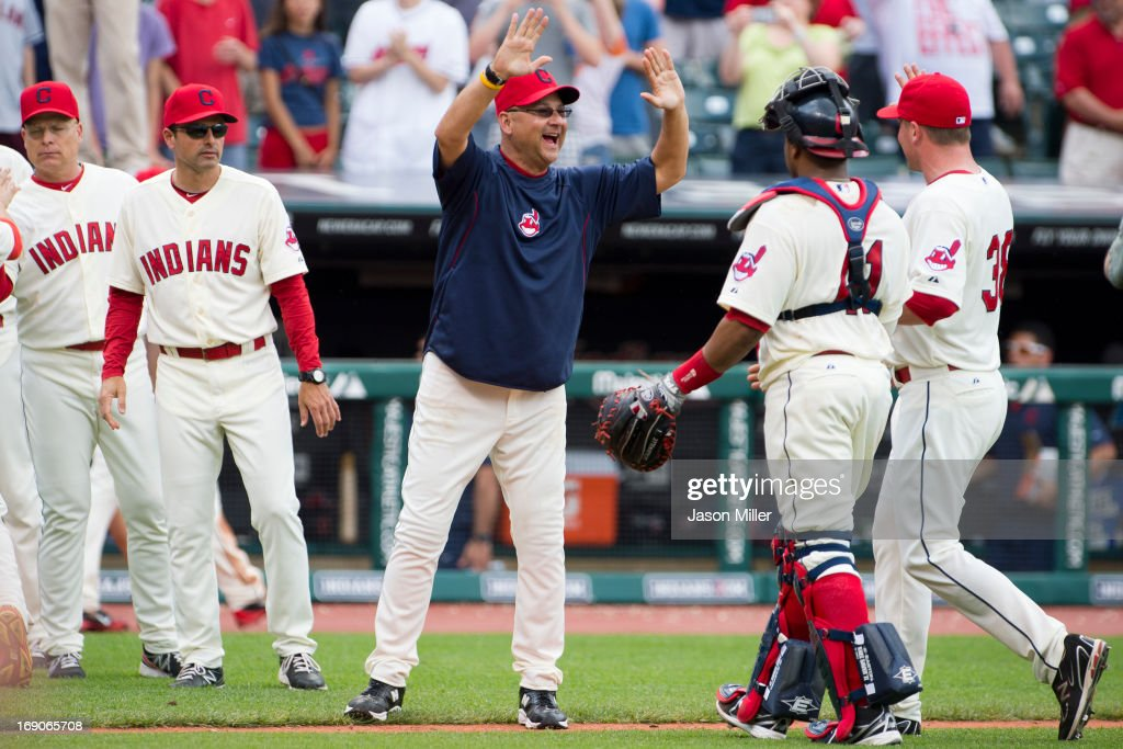 Manager <a gi-track='captionPersonalityLinkClicked' href=/galleries/search?phrase=Terry+Francona&family=editorial&specificpeople=171936 ng-click='$event.stopPropagation()'>Terry Francona</a> #17 celebrates with catcher Carlos Santana #41 and closing pitcher Joe Smith #38 of the Cleveland Indians after the Indians defeated the Seattle Mariners at Progressive Field on May 19, 2013 in Cleveland, Ohio. The Indians defeated the Mariners 6-0.