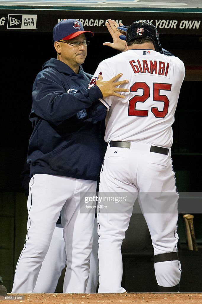 Manager <a gi-track='captionPersonalityLinkClicked' href=/galleries/search?phrase=Terry+Francona&family=editorial&specificpeople=171936 ng-click='$event.stopPropagation()'>Terry Francona</a> #17 celebrates with <a gi-track='captionPersonalityLinkClicked' href=/galleries/search?phrase=Jason+Giambi&family=editorial&specificpeople=194953 ng-click='$event.stopPropagation()'>Jason Giambi</a> #25 of the Cleveland Indians after Giambi hit a solo home run during the sixth inning against the Boston Red Sox at Progressive Field on April 17, 2013 in Cleveland, Ohio.