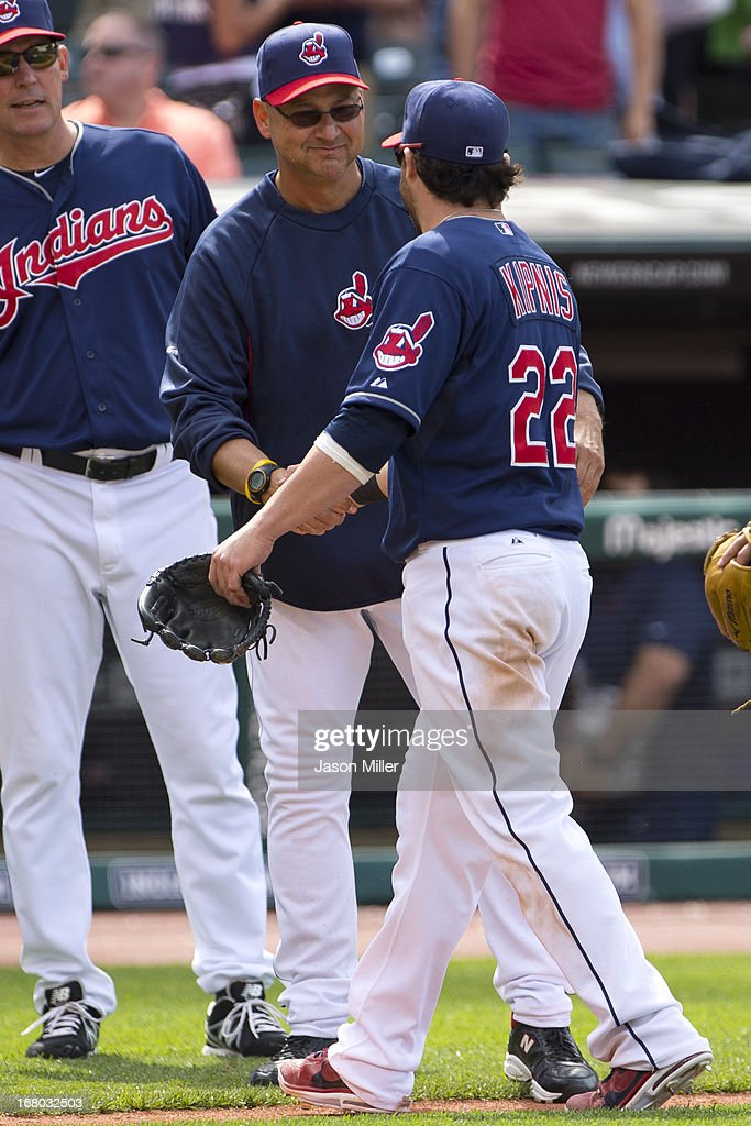 Manager <a gi-track='captionPersonalityLinkClicked' href=/galleries/search?phrase=Terry+Francona&family=editorial&specificpeople=171936 ng-click='$event.stopPropagation()'>Terry Francona</a> #17 celebrates with <a gi-track='captionPersonalityLinkClicked' href=/galleries/search?phrase=Jason+Kipnis&family=editorial&specificpeople=5330784 ng-click='$event.stopPropagation()'>Jason Kipnis</a> #22 of the Cleveland Indians after the Indians defeated the Minnesota Twins at Progressive Field on May 4, 2013 in Cleveland, Ohio. The Indians defeated the Twins 7-3.