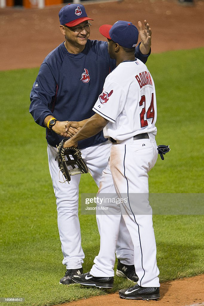 Manager <a gi-track='captionPersonalityLinkClicked' href=/galleries/search?phrase=Terry+Francona&family=editorial&specificpeople=171936 ng-click='$event.stopPropagation()'>Terry Francona</a> #17 celebrates with <a gi-track='captionPersonalityLinkClicked' href=/galleries/search?phrase=Michael+Bourn&family=editorial&specificpeople=835742 ng-click='$event.stopPropagation()'>Michael Bourn</a> #24 of the Cleveland Indians after the Indians defeated the Cincinnati Reds at Progressive Field on May 30, 2013 in Cleveland, Ohio. The Indians defeated the Reds 7-1.