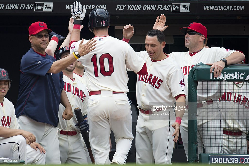 Manager Terry Francona #17 celebrates with Yan Gomes #10 of the Cleveland Indians after Gomes hit a solo home run during the second inning against the Seattle Mariners at Progressive Field on May 20, 2013 in Cleveland, Ohio.