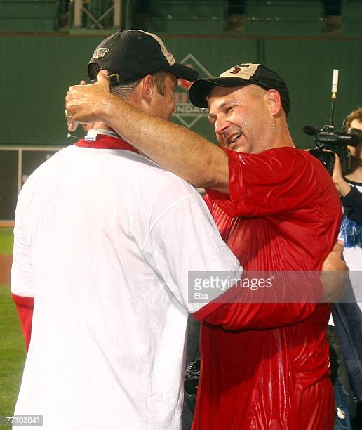 Manager Terry Francona of the Boston Red Sox celebrates with Tim Wakefield after they defeated the Minnesota Twins 52 and the New York Yankees lost...