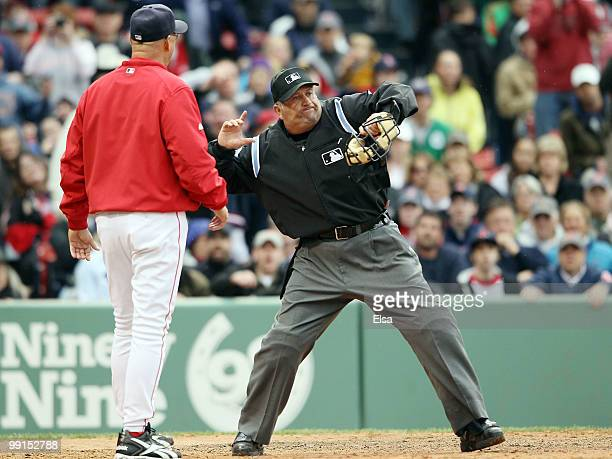 Manager Terry Francona of the Boston Red Sox is thrown out of the game by home plate umpire Dale Scott in the ninth inning against the Toronto Blue...