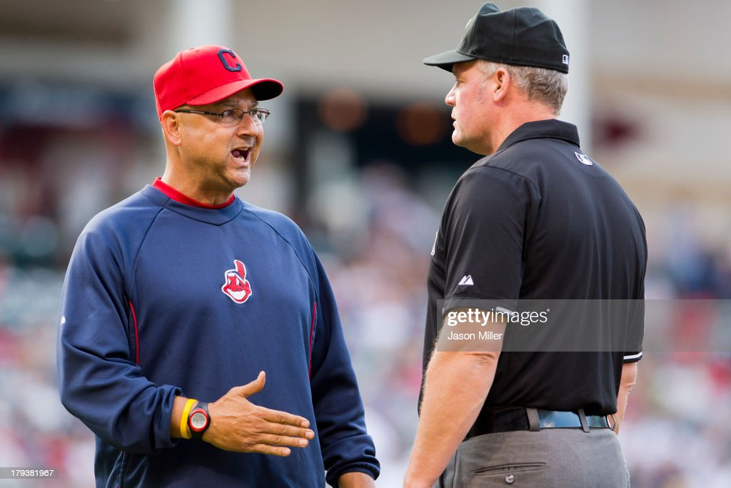 Manager <a gi-track='captionPersonalityLinkClicked' href=/galleries/search?phrase=Terry+Francona&family=editorial&specificpeople=171936 ng-click='$event.stopPropagation()'>Terry Francona</a> #17 of the Cleveland Indians argues a call with first base umpire Ted Barrett #65 during the third inning against the Baltimore Orioles at Progressive Field on September 2, 2013 in Cleveland, Ohio.