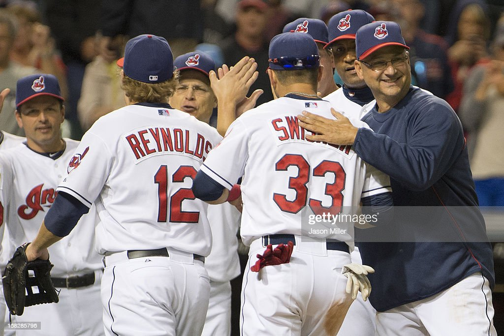 Manager <a gi-track='captionPersonalityLinkClicked' href=/galleries/search?phrase=Terry+Francona&family=editorial&specificpeople=171936 ng-click='$event.stopPropagation()'>Terry Francona</a> #17 of the Cleveland Indians celebrates with his players after the Indians defeated the Oakland Athletics at Progressive Field on May 7, 2013 in Cleveland, Ohio. The Indians defeated the Athletics 1-0.