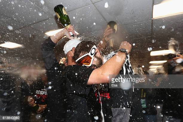 Manager Terry Francona of the Cleveland Indians celebrates with Andrew Miller in the clubhouse after defeating the Boston Red Sox 43 in game three of...