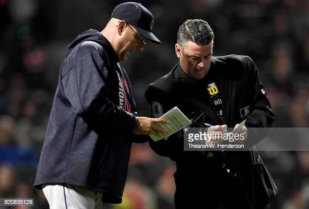 Manager Terry Francona of the Cleveland Indians comes out to inform home plate umpire Rob Drake of changes he's making to his line up against the San...