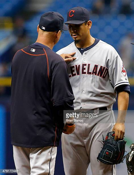 Manager Terry Francona of the Cleveland Indians comes out to take pitcher Carlos Carrasco of the Cleveland Indians off the mound after Carrasco gave...