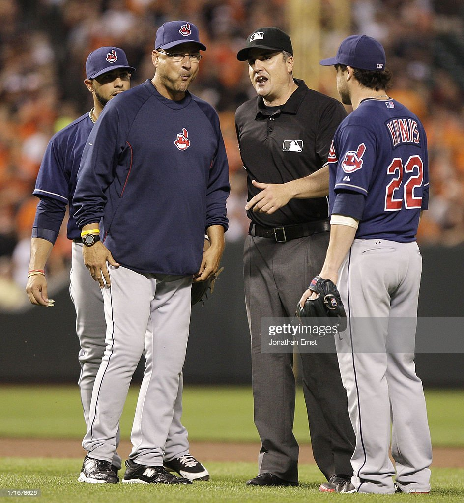 Manager <a gi-track='captionPersonalityLinkClicked' href=/galleries/search?phrase=Terry+Francona&family=editorial&specificpeople=171936 ng-click='$event.stopPropagation()'>Terry Francona</a> (L) of the Cleveland Indians gets a ruling from umpire Mike DiMuro (C) after baserunner Adam Jones #10 of the Baltimore Orioles (not pictured) was called out for abandoning his base during the fifth inning at Oriole Park at Camden Yards on June 27, 2013 in Baltimore, Maryland. Jones mistakenly thought he'd been called out on a fielder's choice, and returned to the dugout.