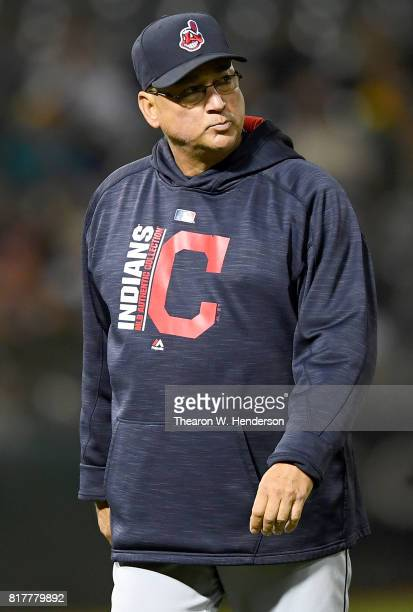 Manager Terry Francona of the Cleveland Indians looks on as he walks back to the dugout after making a pitching change against the Oakland Athletics...