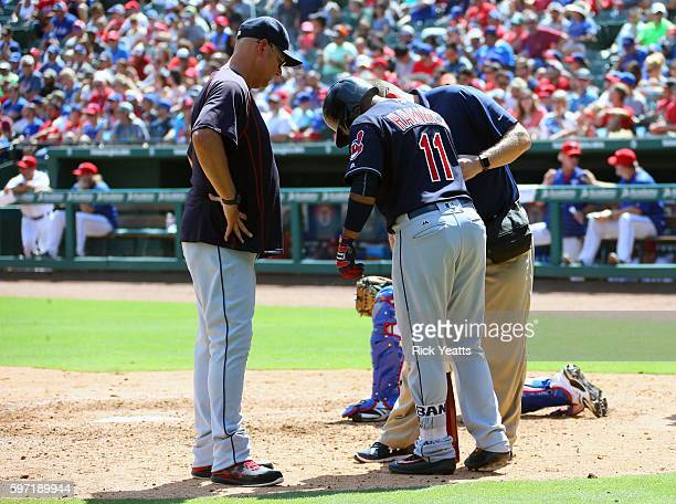 Manager Terry Francona of the Cleveland Indians looks on as s trainer checks out Jose Ramirez after he was hit by a foul tip in the fifth inning...