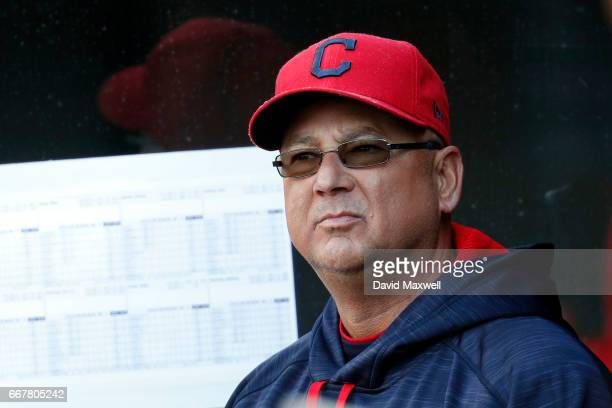 Manager Terry Francona of the Cleveland Indians looks out from the dugout before the start of the game against the Chicago White Sox at Progressive...