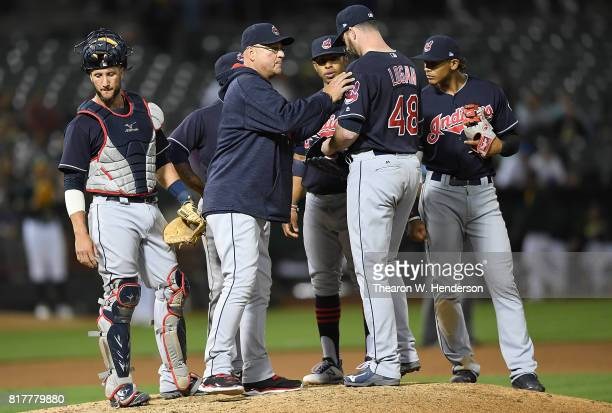 Manager Terry Francona of the Cleveland Indians makes a pitching change handing the ball over to relief pitcher Boone Logan against the Oakland...