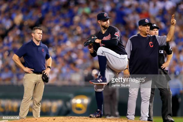 Manager Terry Francona of the Cleveland Indians motions for a replacement after starting pitcher Corey Kluber of the Cleveland Indians is injured...