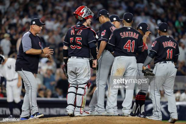 Manager Terry Francona of the Cleveland Indians removes starting pitcher Carlos Carrasco during the sixth inning against the New York Yankees in game...