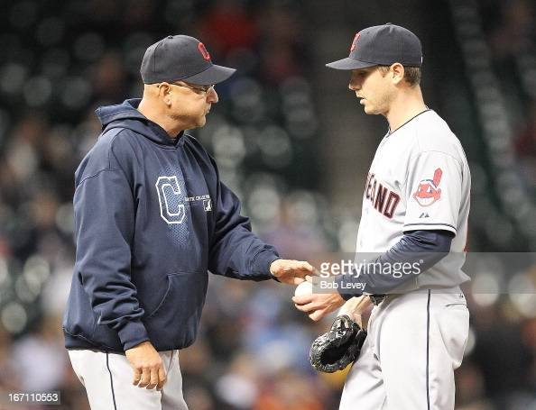 Manager Terry Francona of the Cleveland Indians takes the ball from Scott Kazmir of the Cleveland Indians as he leaves the game in the fourth inning...