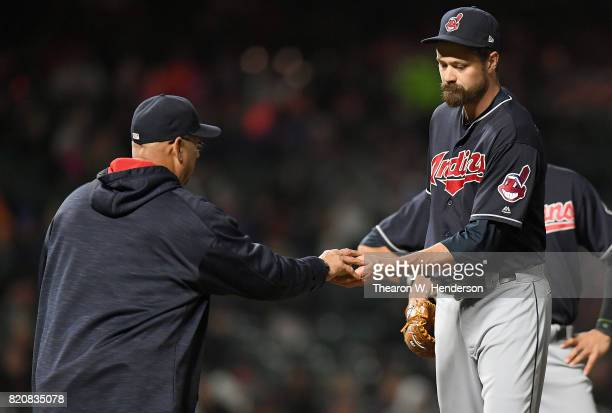 Manager Terry Francona of the Cleveland Indians takes the ball from relief pitcher Andrew Miller taking Miller out of the game against the San...