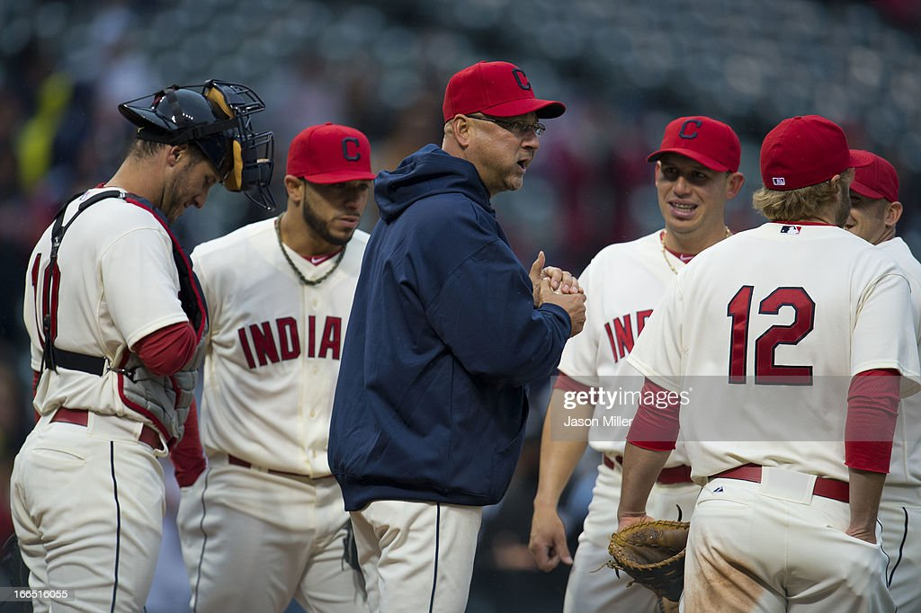 Manager Terry Francona #17 of the Cleveland Indians talks to his team during a pitching change during the seventh inning against the Chicago White Sox at Progressive Field on April 13, 2013 in Cleveland, Ohio.