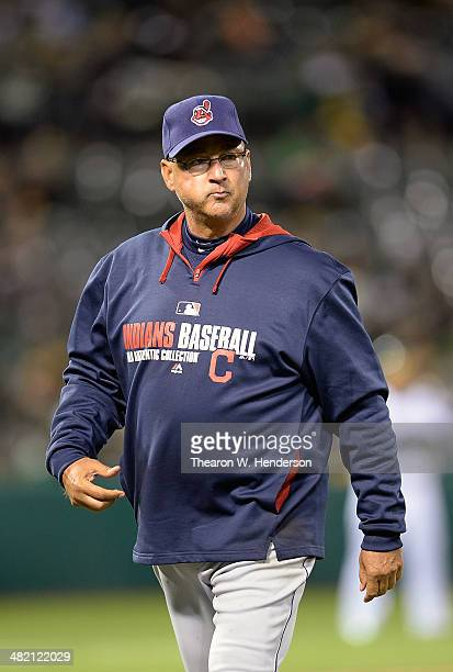 Manager Terry Francona of the Cleveland Indians walks back to the dugout after making a pitching change against the Oakland Athletics in the bottom...