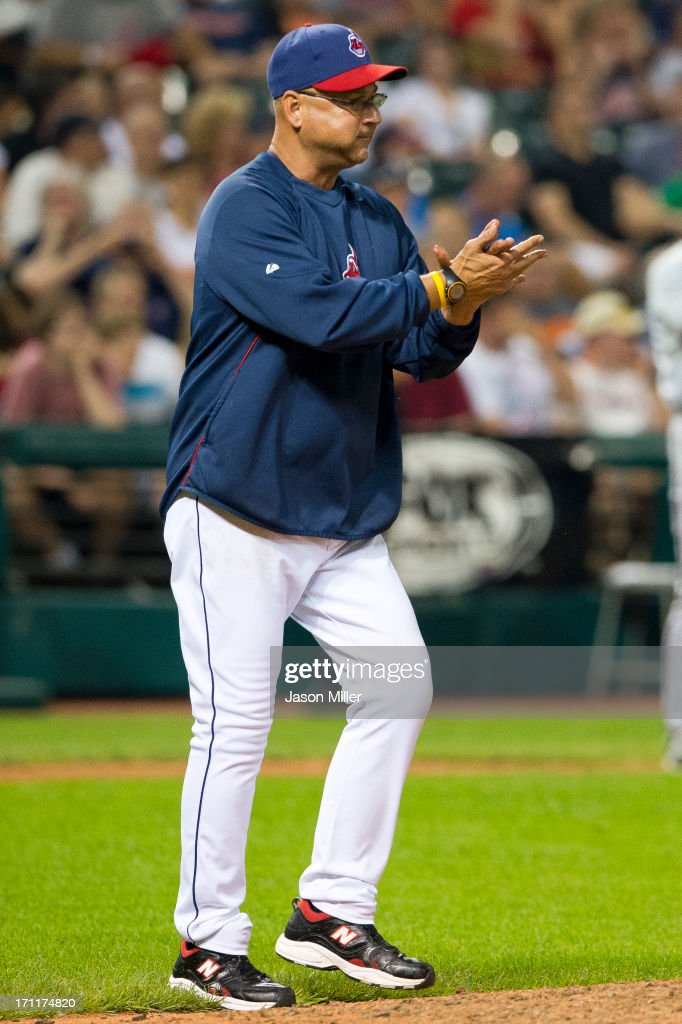 Manager <a gi-track='captionPersonalityLinkClicked' href=/galleries/search?phrase=Terry+Francona&family=editorial&specificpeople=171936 ng-click='$event.stopPropagation()'>Terry Francona</a> #17 of the Cleveland Indians walks to the mound for a pitching change during the seventh inning against the Minnesota Twins at Progressive Field on June 22, 2013 in Cleveland, Ohio.