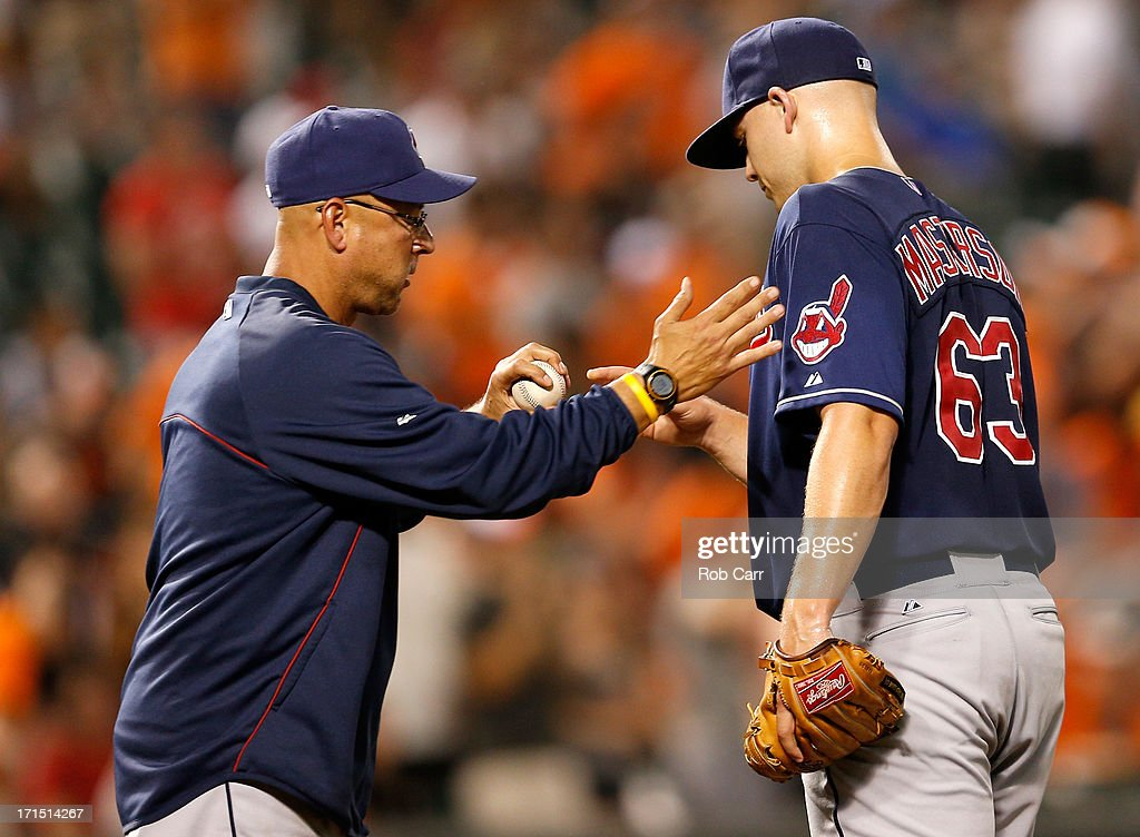 Manager <a gi-track='captionPersonalityLinkClicked' href=/galleries/search?phrase=Terry+Francona&family=editorial&specificpeople=171936 ng-click='$event.stopPropagation()'>Terry Francona</a> removes starting pitcher <a gi-track='captionPersonalityLinkClicked' href=/galleries/search?phrase=Justin+Masterson&family=editorial&specificpeople=4950538 ng-click='$event.stopPropagation()'>Justin Masterson</a> #63 of the Cleveland Indians from the game during the seventh inning of the Indians 6-3 loss to the Baltimore Orioles at Oriole Park at Camden Yards on June 25, 2013 in Baltimore, Maryland.