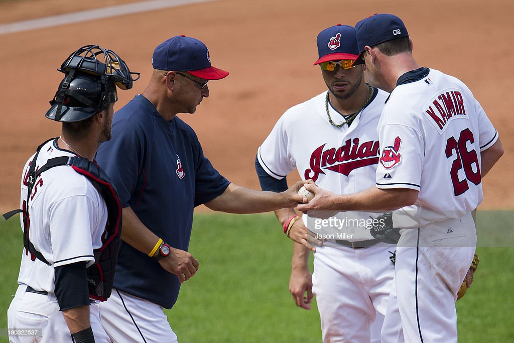 Manager <a gi-track='captionPersonalityLinkClicked' href=/galleries/search?phrase=Terry+Francona&family=editorial&specificpeople=171936 ng-click='$event.stopPropagation()'>Terry Francona</a> #17 removes starting pitcher <a gi-track='captionPersonalityLinkClicked' href=/galleries/search?phrase=Scott+Kazmir&family=editorial&specificpeople=217724 ng-click='$event.stopPropagation()'>Scott Kazmir</a> #26 of the Cleveland Indians from the game during the fifth inning against the Kansas City Royals at Progressive Field on September 11, 2013 in Cleveland, Ohio. The Royals defeated the Indians 6-2.